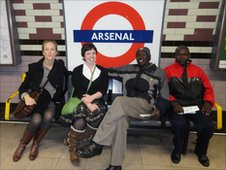 Debbie Martin, Sarah Stevens, Naboth Okadie, Martin Bitei waiting for a tube train to visit Arsenal's Emirates Stadium