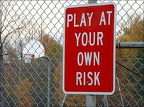 "sign saying ""play at your own risk"""