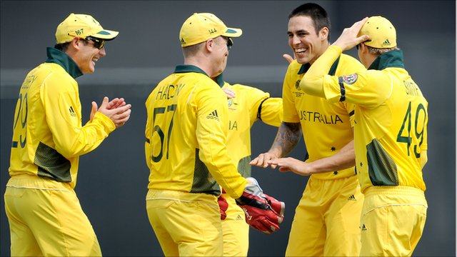 Mitchell Johnson celebrates with team-mates