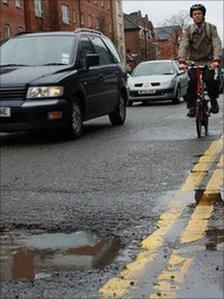 Cyclist and pothole
