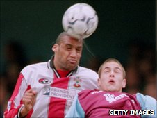 Richards beats Joe Cole to a header in 2001