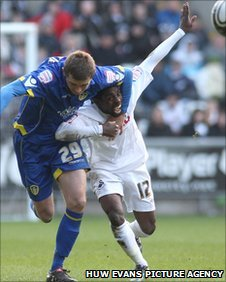 Nathan Dyer is challenged by George McCartney