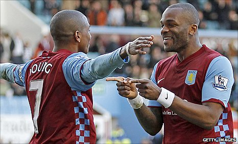 Ashley Young (left) scores a penalty and celebrates with striker Darren Bent in the win over Blackburn Rovers