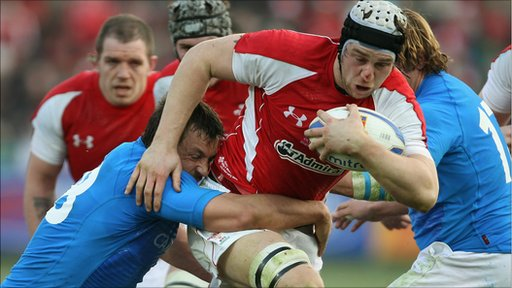 Valerio Bernabo of Italy tackles Ryan Jones of Wales