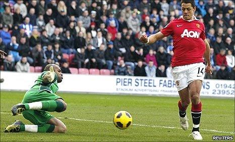 Javier Hernandez scores the opening goal