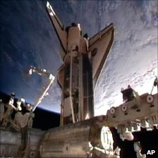Nasa television video grab of space shuttle Discovery moments after docking at the International Space Station