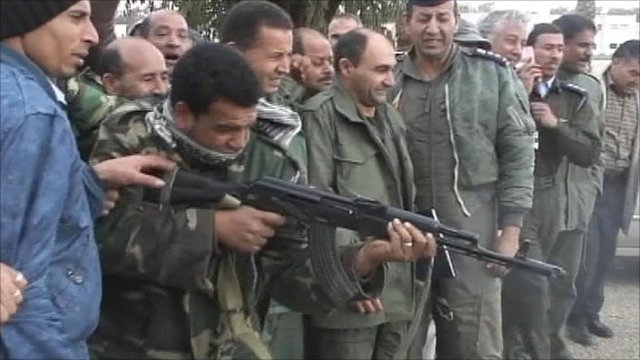 Benghazi military shoot pictures of Col Gaddafi