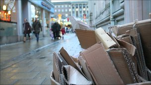 cardboard waste stacked on a street