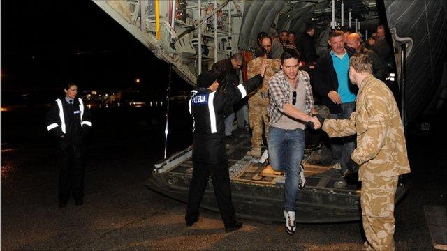 People arriving on the RAF Hercules