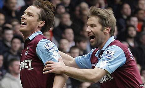 West Ham midfielder Scott Parker (left) celebrates his opener against Liverpool with team-mate Thomas Hitzlsperger