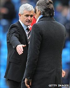 Mark Hughes and Roberto Mancini shake hands