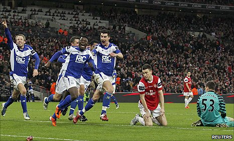 Martins and Birmingham celebrate after an Arsenal mix-up