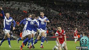Obafemi Martins and Birmingham celebrate after an Arsenal mix-up