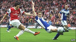 Samir Nasri (left) shoots for goal for Arsenal in the final