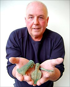 Treasure hunter Maurice Richardson holds three of the items from the Bronze Age haul