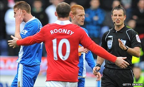 Rooney (centre) protests his innocence as McCarthy rubs his head