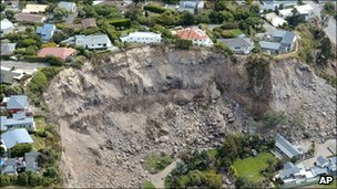 Giant rocks at the site of a quake-triggered landslide in Christchurch, New Zealand