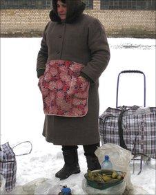 Nadia, 62, selling picked gherkins
