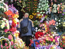 Plastic flower stall at Lubny market