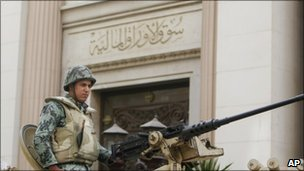 A soldier guards the Egyptian Stock Exchange Market