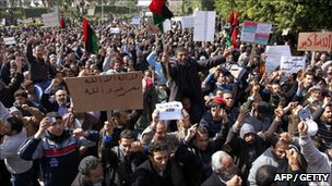 Libyan anti-government protesters wave their old national flag in the western city of Zawiya on February 27
