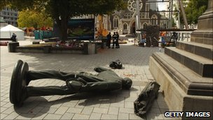 The fallen statue of John Robert Godley in Cathedral Square, Christchurch, on Tuesday
