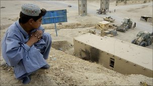 Afghan boy watching construction