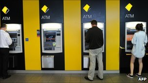 File image of customers using Commonwealth Bank ATMs in Sydney on 18 February 2011