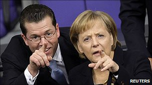 Karl-Theodor zu Guttenberg and Angela Merkel