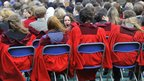 Students await the arrival of Britain's Prince William and his fiancee Kate Middleton during their visit to St Andrews University in Fife