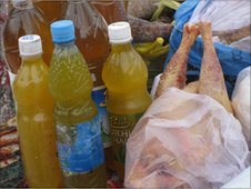 Homemade oil and chicken, Kiev market