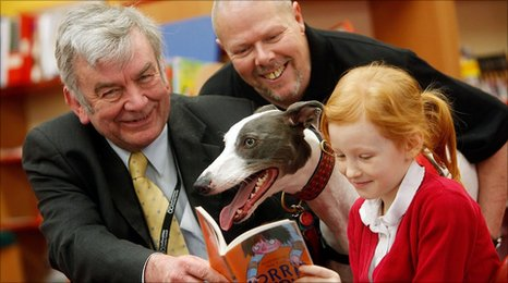 Staffordshire County Councillor Michael Oates and Tony Nevett from READ with Danny the dog and nine-year-old Alyson