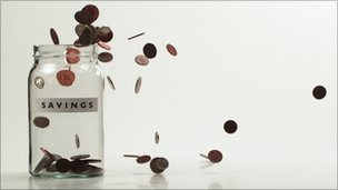 Money falling in jar