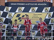 Casey Stoner on the winner's podium at Aragon in 2010