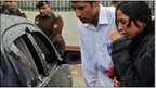 Unidentified relatives of Shahbaz Bhatti inspect his bullet-riddled car in Islamabad on 2 March 2011