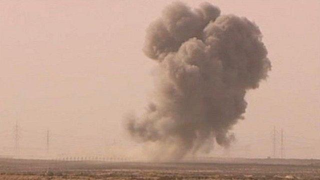 Smoke plume after air attack at Ajdabiya, Libya