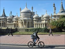 Cyclist in front of the Royal Pavilion in Brighton.