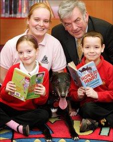Children read to listening dog