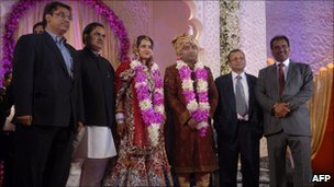 Newlyweds Yogita (third from left) and Lalit Tanwar (third from right) pose with family members