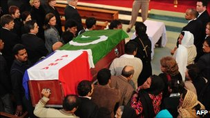 Pakistani mourners carry the coffin of slain minister Shahbaz Bhatti into the Fatima Church for the funeral ceremony in Islamabad on March 4, 2011.