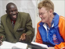 Mari Sophia Elizabeth Van Dyke from Jan Mohr High School chats to a Kenyan teacher (Copyright Matt Grayson)