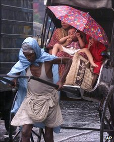 A man pulling a rickshaw by hand in Calcutta