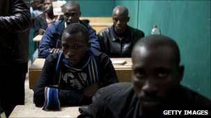 Alleged mercenaries from Mali and Nigeria, being held in a classroom by Libyan anti-government rebels in the western city of Zintan, 28 February 2011