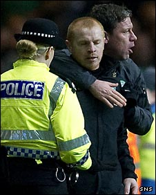 Neil Lennon is restrained by Celtic coach Alan Thompson