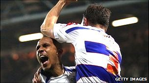 Clint Hill of QPR celebrates scoring a goal with Fitz Hall