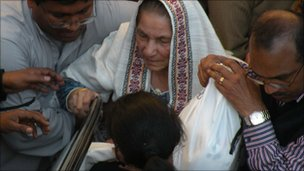 The mother of Shahbaz Bhatti arrives for his funeral