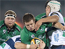 Connacht's Sean Cronin is tackled by Marco Filippucci and Benjamin Vermaak of Treviso