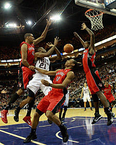 Travis Outlas of the New Jersey Nets drives against the Toronto Raptors in London