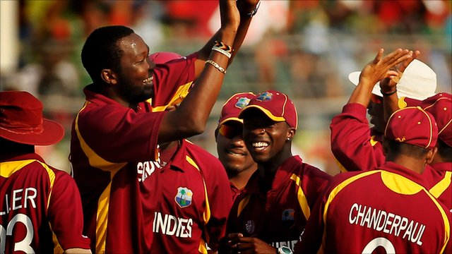 West Indies' Sulieman Benn celebrates with team mates