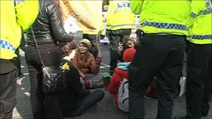 A small number of protesters blocked the road outside the Lib Dem conference venue